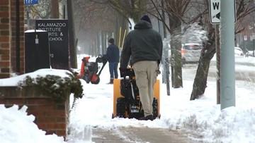 Snow cleanup commences in Michigan
