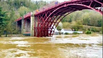 English river breaches flood barriers