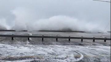 Coastal flooding spills inland as waves slam ashore