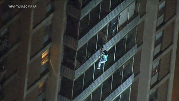 Video shows man climbing down Philly high-rise to escape a fire