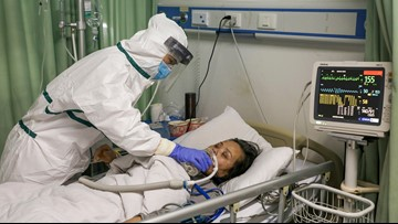 China's virus death toll at 811, surpasses SARS but new cases fall