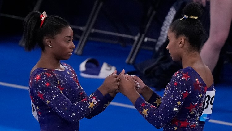 Why do Team USA gymnasts wear different color leotards?