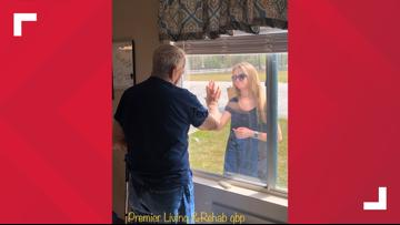 Woman shares engagement through window with grandfather quarantined inside nursing home