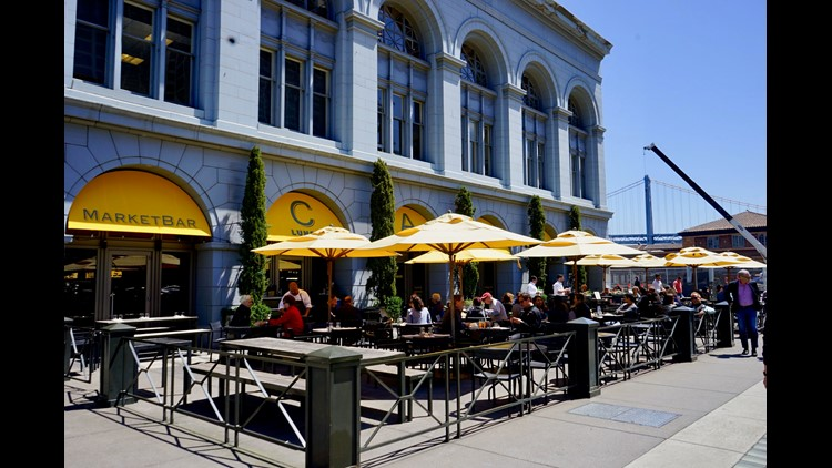 The historic Ferry Terminal hosts Blue Bottle Coffee, a butcher, a cheese shop, fine dining and a farmers market inside and outdoors with bay views.