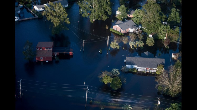 2 detainees drown as van swept into floodwaters in SC