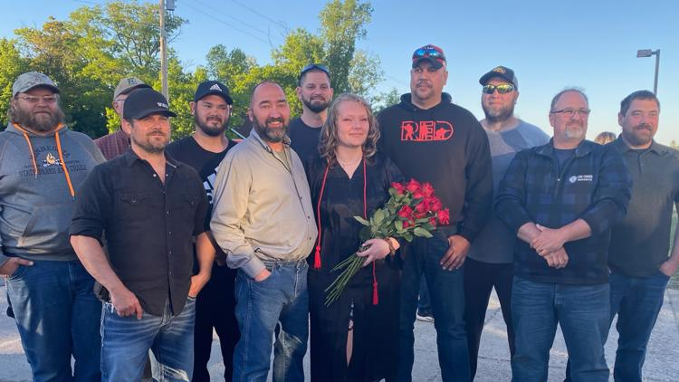 High school graduate's 'fill-in dads' step up during father's deployment