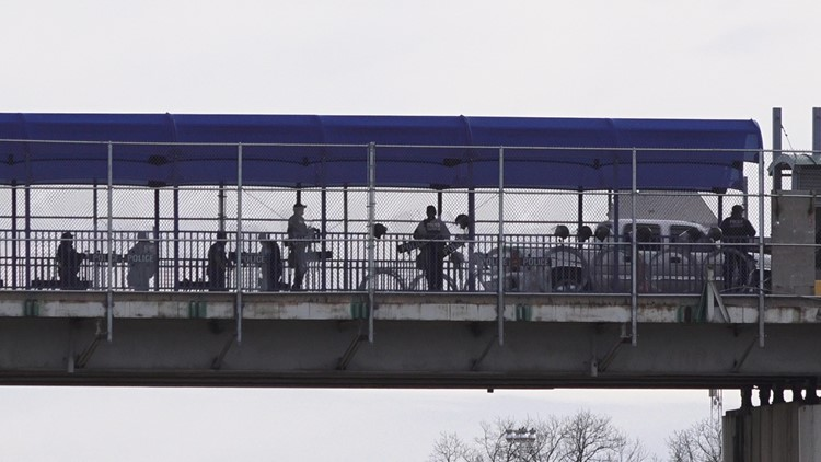US Customs and Border Protection agents manage a pedestrian queue Eagle Pass Bridge I