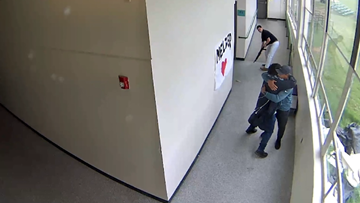 Powerful video shows security guard hugging student moments after disarming him