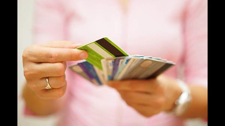 woman choose one credit card, concept of credit debt. Photo: Thinkstock.