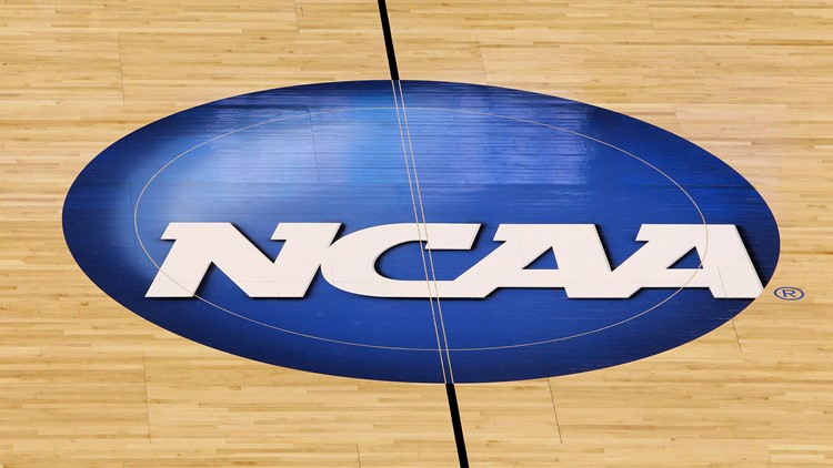 A detail of a NCAA logo decal is seen at center court in 2010.