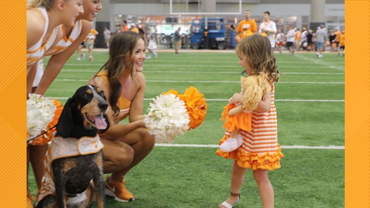 Vol cheerleaders greet a young girl