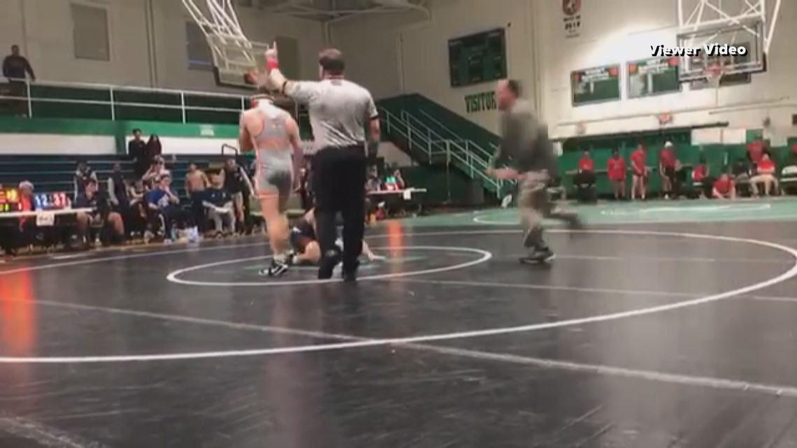 VIDEO: Dad charged with assault after tackling student who was wrestling his son