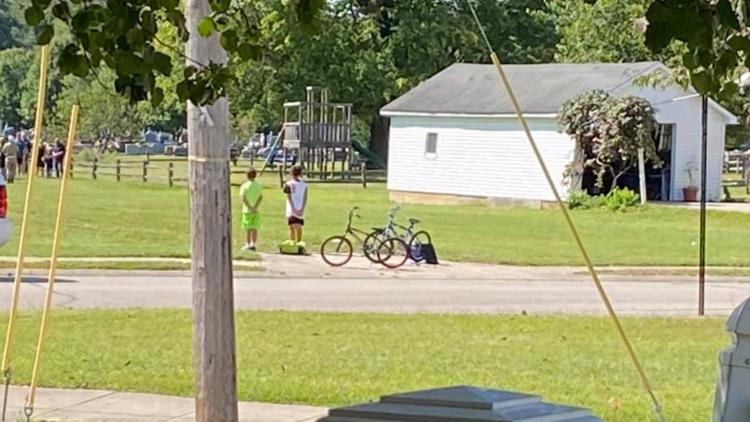 Boys stop bike ride to pay respects at veteran's funeral in Indiana