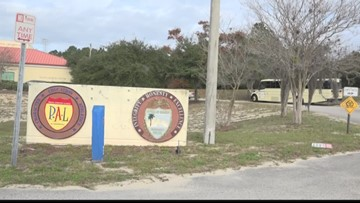 Police Athletic League members clean vandalism from bus for kid's organization