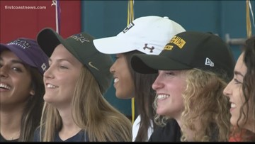 High school athletes participate in signing day along the First Coast