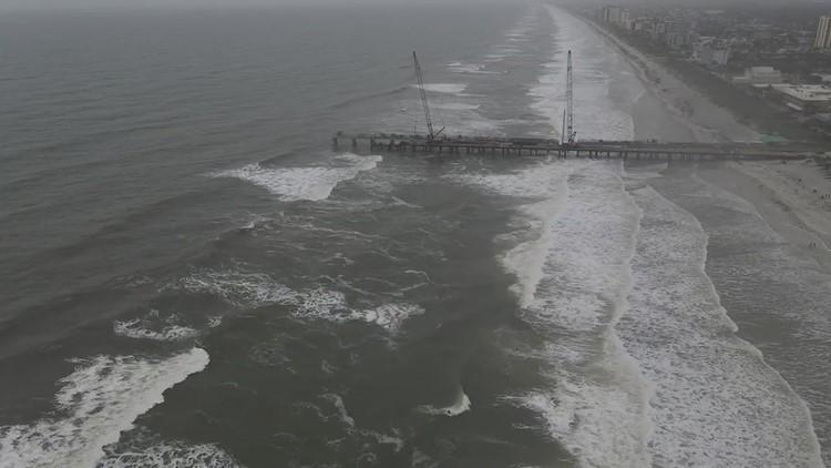 Surfers in Eta waves Wednesday