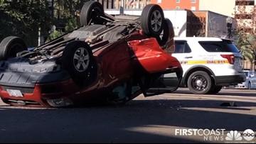Crash involving flipped car blocks lanes in Downtown Jacksonville