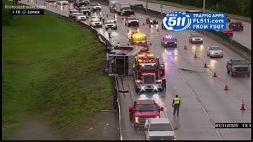 JTA bus flips in heavy downpour on I-10 at Lennox Avenue