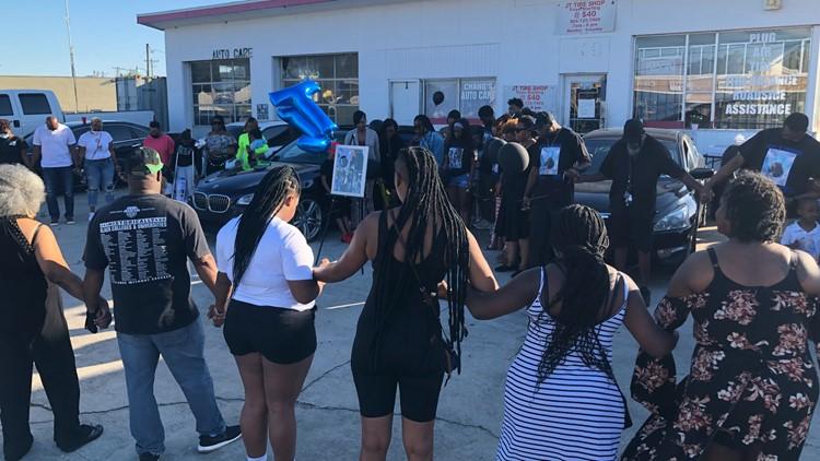 Community mourns beloved business owner killed outside shop during vigil
