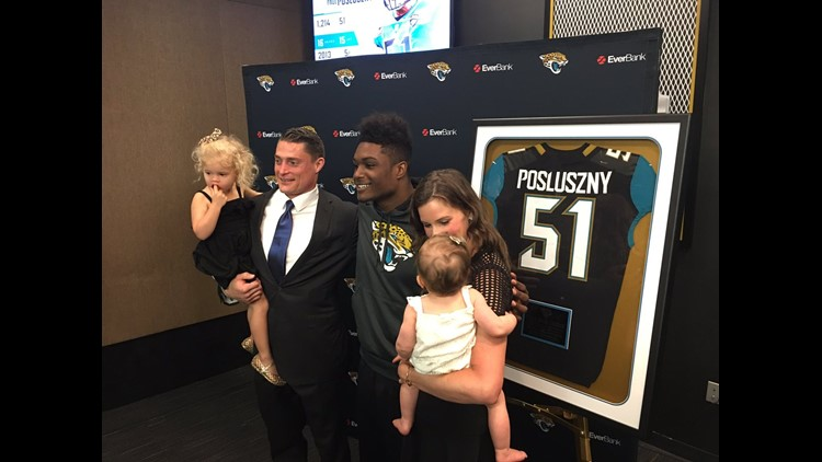 Paul Posluszny and family pose with Jaguars middle linebacker Myles Jack during a retirement ceremony at EverBank Field. (Photo Courtesy: Mike Kaye, First Coast News).