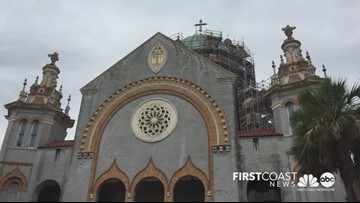 Historic cross is placed back on St. Augustine church