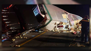 Two rescued after being pinned under a semi truck in five-car crash on I-75