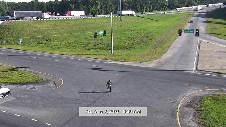 Naked man barricaded inside vehicle on I-95 in Glynn County taken into custody, police say