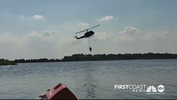 Helicopter scoops water to combat Yellow Bluff Fire