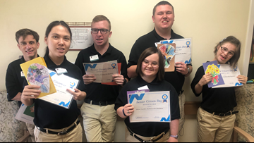 Interns give cards to residents for National Senior Citizen day