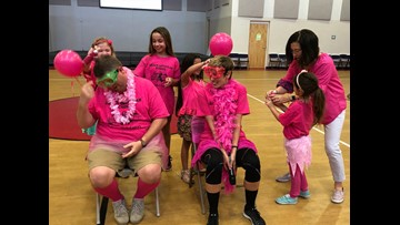 They did what?! Students spray paint principal, pastor's hair pink for a good cause