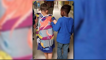 7-Year-Old in head-on collision struggles to walk; friend helps him take first steps