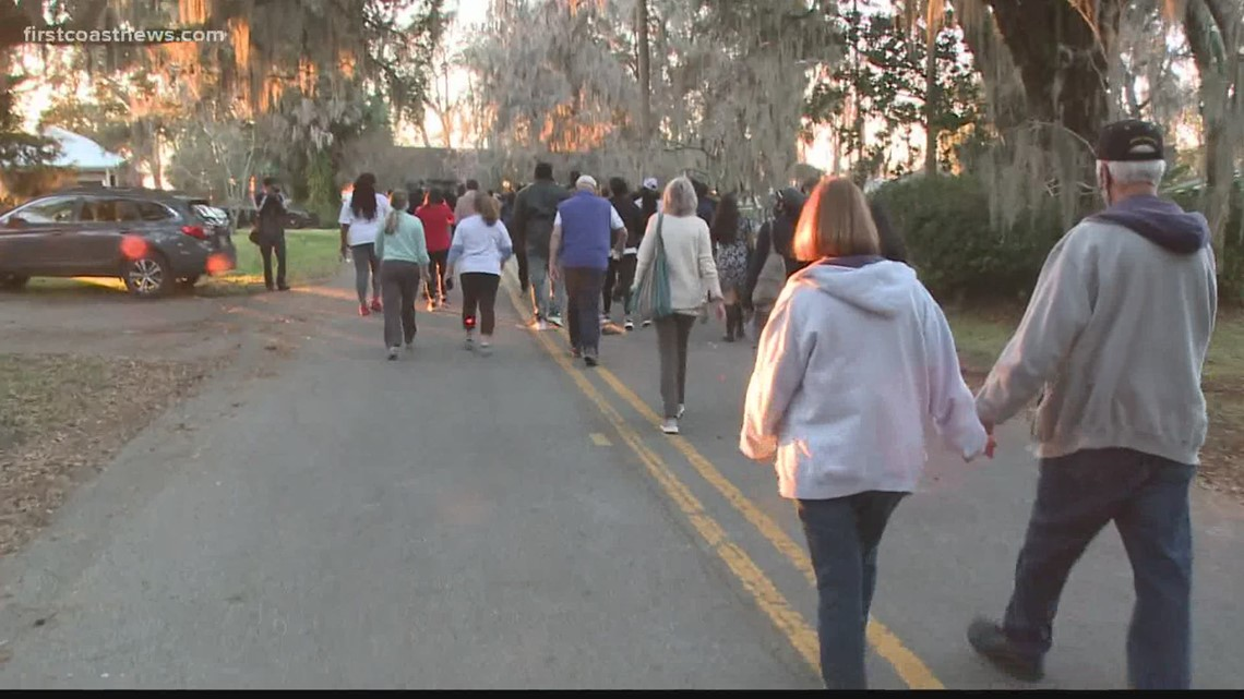 Community holds memorial walk remembering final moments of Ahmaud Arbery's life