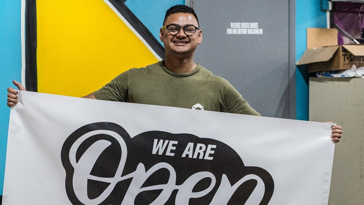 Jacksonville printing company paying it forward by giving away free 'We Are Open' signs to small businesses