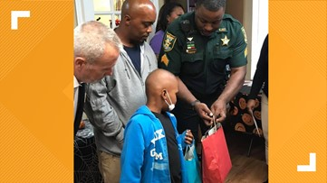 Deputy gifts boy with cancer an all-inclusive trip to Disney World