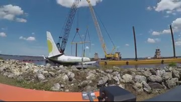 WATCH | Time lapse footage of Boeing 737 being lifted from water, placed on barge for transport down St. Johns River