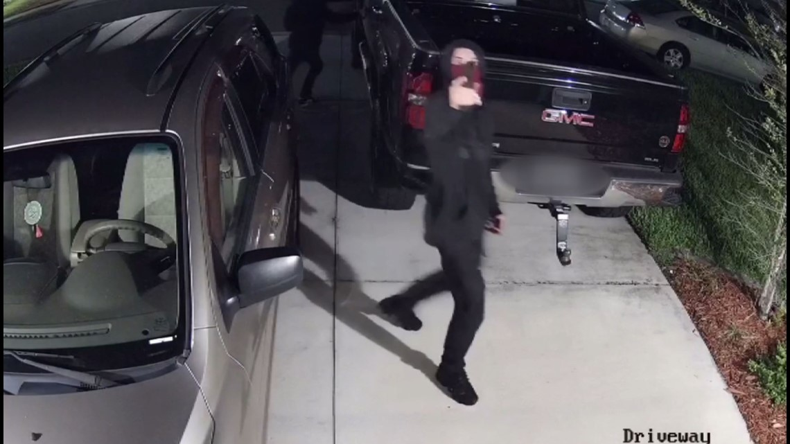 Community captures burglars going through vehicles, pointing gun at surveillance cameras after stealing weapons