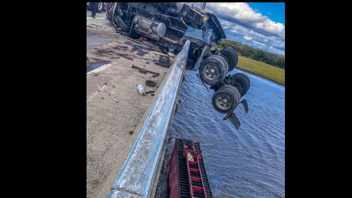 PHOTOS: Semi left dangling on Dames Point Bridge after four