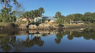 Neighbor concerned about concrete dumped into canal near intra-coastal waterway