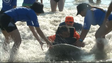 Surf session for dozens of people with disabilities held at Jacksonville Beach, hosted by Brooks Rehab
