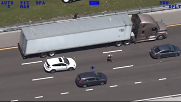VIDEO: Deputies capture wanted Jacksonville man after he runs under a moving semi truck on I-4