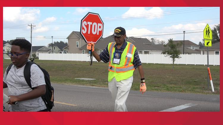 Mr. Mel helping kids cross the street