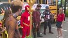 Superheroes help 'Stuff the Bus'