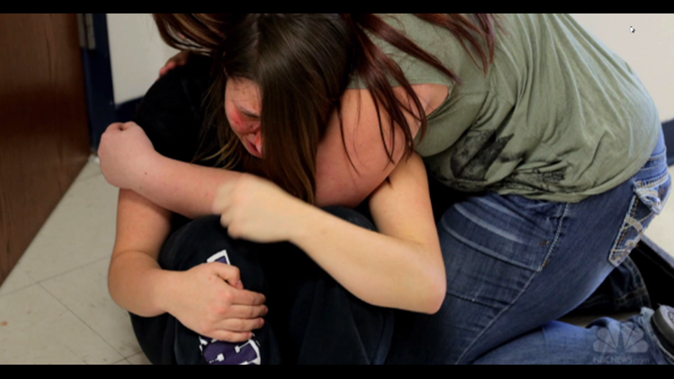 Students hugging after active shooter drill