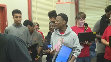 Free laptops donated to computer science students at Andrew Jackson High School