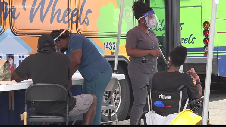 Mobile vaccination bus is seeing fewer people getting the shot while COVID testing surges
