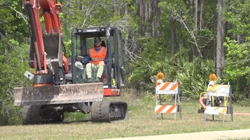 JEA crews work to repair water main break on Race Track Road in St. Johns County
