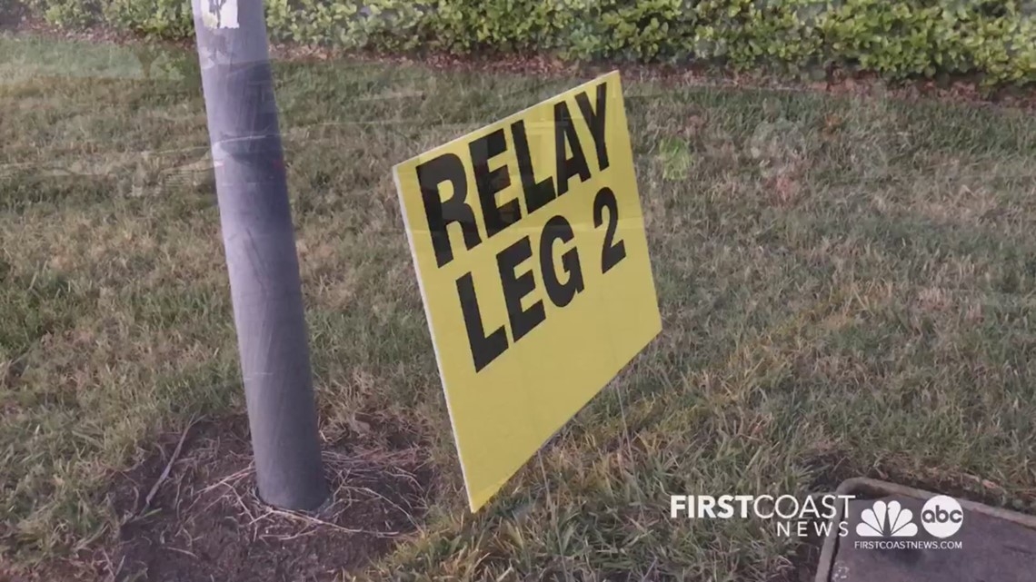 The relay baton pass zone is being set up for the 26.2 DONNA Marathon