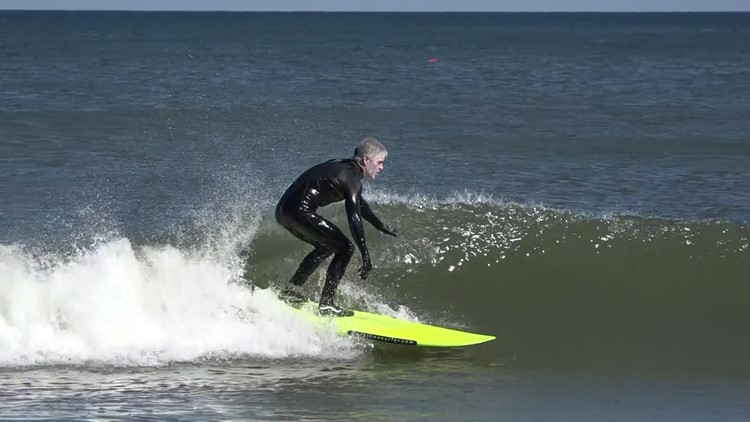 Jacksonville Beach surfer crushes old surfing marathon record to raise money for Deck the Chairs