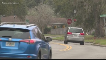 Mother wants a change after drivers are failing to stop at sign near Fort Caroline Elementary