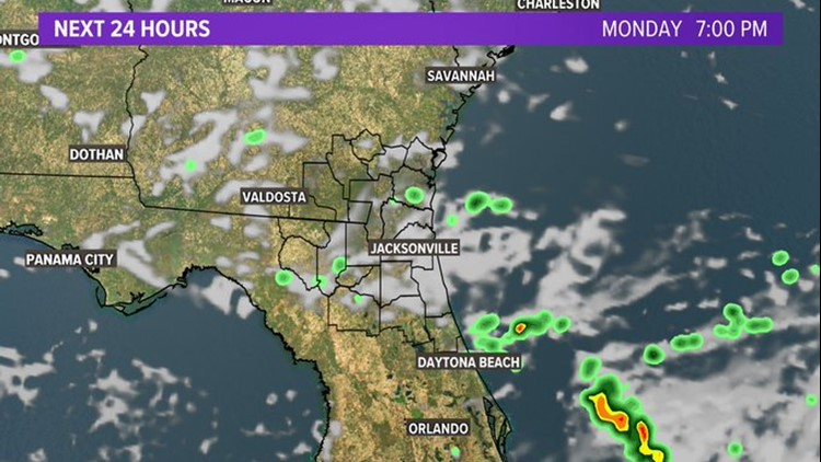 LOCAL: Showers moving out, clouds gradually clearing Monday